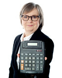 Business professional showing calculator to camera