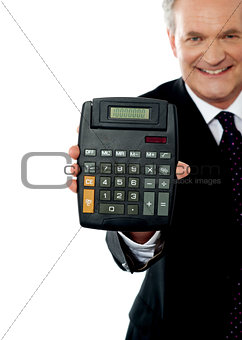 Cropped image of a businessman showing calculator