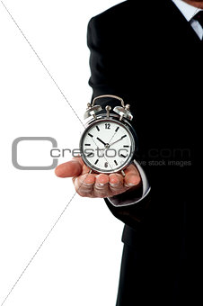 Cropped image of a man with alarm clock on his palm