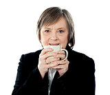 Old woman holding coffee mug