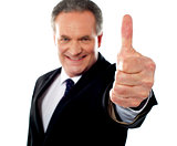 Successful entrepreneur gesturing thumbs-up