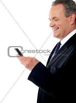 Business executive reading text sms