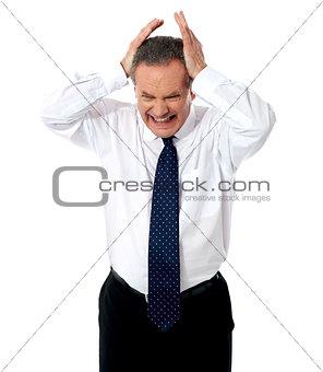 Aged businessman in depression