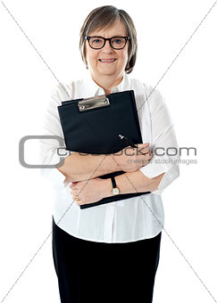Portrait of senior businesswoman holding reports