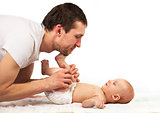 Young Caucasian father playing with baby son