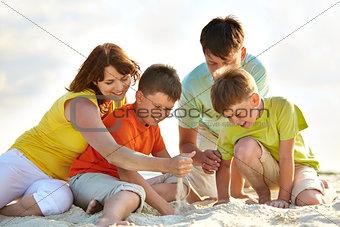 Family on sand