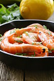 shrimp fried with herbs and spices in a pan