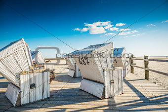 Beach chairs on wooden ground