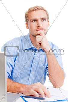 young man at office thinking