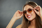 Woman wearing sunglasses and smiling