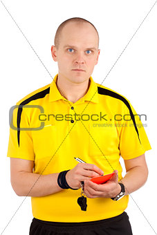 Football referee writing on red card