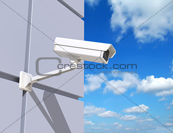 Security Camera Mounted on the Facade of the Building