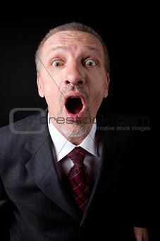 Mature businessman shouting at camera