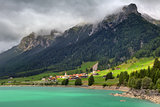 Small village and alpine lake in Switzerland.
