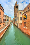 Small canal and typical buildings in Venice, Italy.
