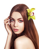 Pampering. Serene Woman with Orchid Fresh Flower in Hair. Tenderness