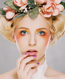 Elegance. Genuine Natural Blonde Bride with Pink Flowers. Artistry