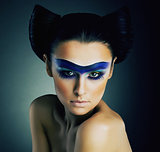 Haute Couture. Fantasy. Classy Woman with Blue Painted Mask and Modern Hairstyle