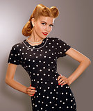 Romance. Styled Woman in Blue Retro Polka Dot Dress. Pin Up Style
