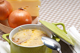 oinion soup with melted cheese and bread on top