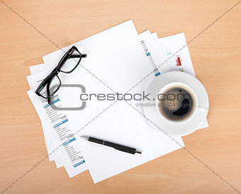 Blank paper with pen, glasses and coffee cup