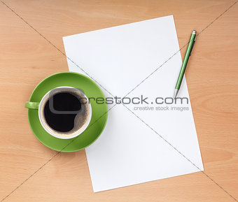 Blank paper with pen and coffee cup