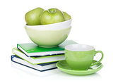 Ripe green apples, coffee cup and books