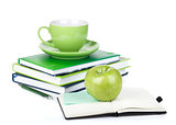 Ripe green apple, coffee cup and office supplies