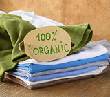 stack of multicolored clothing with organic label