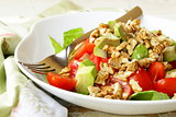 salad mix with avocado,  tomatoes and walnuts