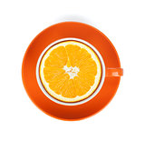 Ripe orange in tea cup