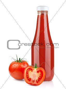 Tomato ketchup bottle and ripe tomatoes