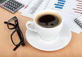 Coffee cup on contemporary workplace