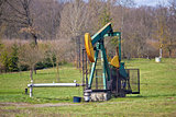 Oil pump in green nature