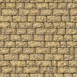 Seamless Texture of Yellow Decorative Bricks Wall.