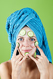 woman in blue towel and mask from cucumber 