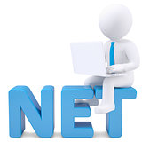 3d white man with laptop sitting on the word NET