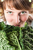 woman and fresh savoy cabbage