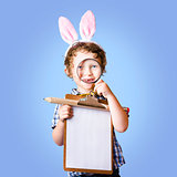 Delightful young boy holding easter wish list