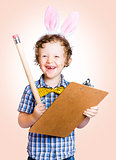 Lovable easter child holding clipboard and pencil