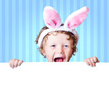 Excited young child holding blank easter banner