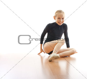 Girl sitting on floor in bodysuit