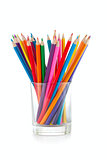 color pencils pile in glass isolated