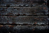 Closeup burned wooden wall after fire