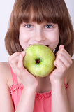 child with a green apple