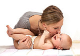 Young Caucasian woman kissing her baby son