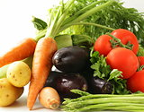 fresh spring vegetables - carrots, tomatoes, asparagus, eggplant and potatoes