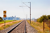 Indian Hinterland landscape with railroad track