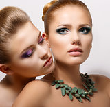 Bonding. Allure. Faces of Two Sensual Pretty Women Closeup. Aspiration
