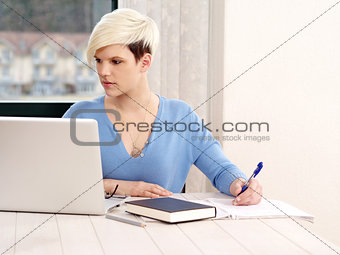 Pretty female working on laptop